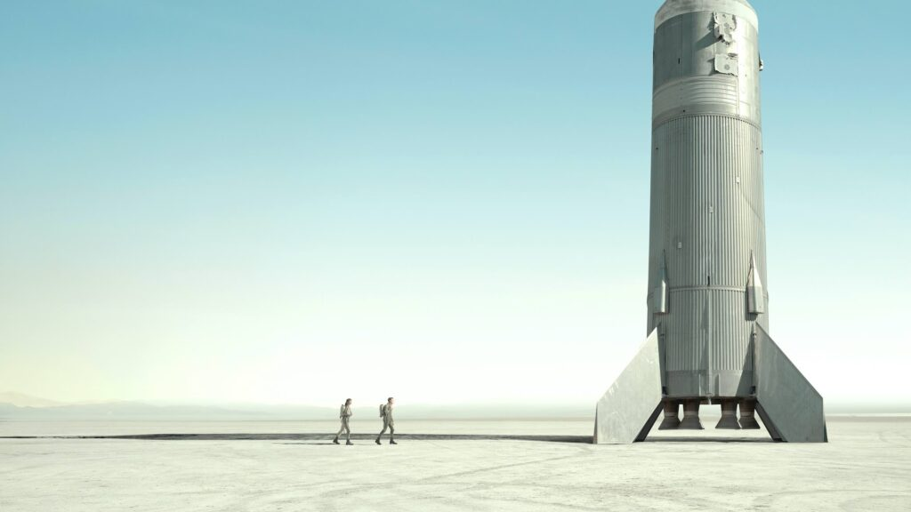 Astronaut walking to rocket ship on launch site