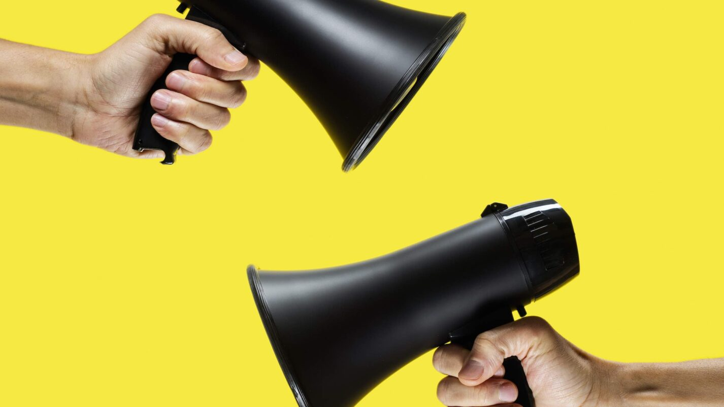 men with a megaphone in their hands on a yellow background